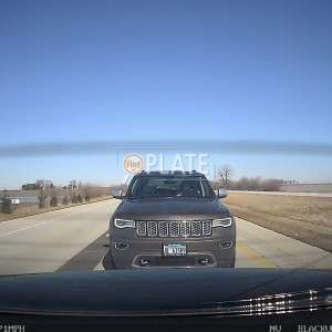 Unfortunate that you were born with extra chromosomes lady in the shitty jeep. Next time learn to follow at an appropriate distance!